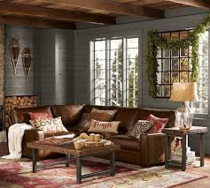 pottery barn sectional leather sofa grey painted wooden deck wall leather pillow throws wooden coffee table
