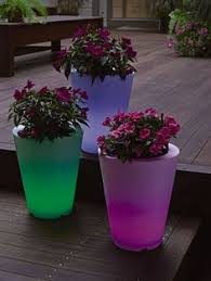 rust oleum glow in the dark paint flower pots. we could just use glow in the dark paint tho. solar illuminated planters add an unexpected to any patio or deck. rust oleum flower pots