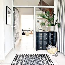 in praise of outdoor rugs used indoors all the little details