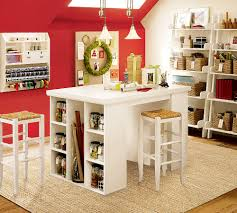 ... delectable home art room with white crafting table and red walls also  wicker baskets ...