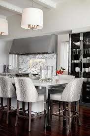 kitchen island with stainless steel legs and white drum light pendants