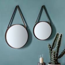 set of two round mirrors with faux leather straps
