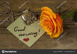 good morning text on a paper orange rose flower and decoration stock photo