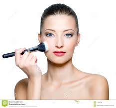 beautiful woman doing make up on face
