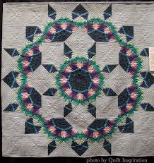 Pineapple delight: Pineapple log cabin quilts! | Quilt Inspiration ... & This elegant creation is a cross between a Lone Star and a Pineapple quilt.  Judy Birchett says that When Pineapples Kaleide was based on the New Day  Dawning ... Adamdwight.com