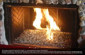 legacy premixed diamond fire pit glass installed in an indoor fireplace