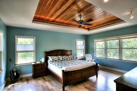 Tray Ceiling Bedroom Features Warm Wood Tray Ceiling A Wood Paneled Tray