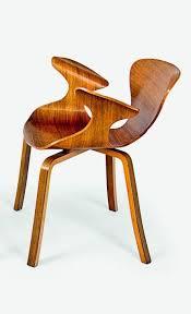 amazing furniture designs. moulded walnut veneer plywood prototype armchair looks amazing furniture designs 0