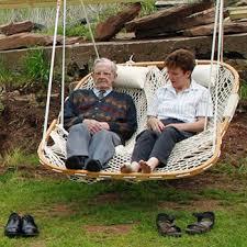 a couple enjoy a cobble mountain double chair