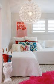 chic girls playroom featuring cool gray walls and ikea ps maskros over white sectional sofa filled with blue and gray paisley pillows and white
