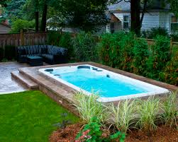 Hydropool Self Cleaning swim spa installed in ground with stone deck. Learn  more about Hydropool. Small Backyard ...