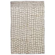 moroccan rug made of natural cream and brown wool for
