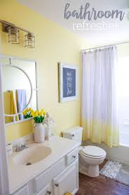 ... Curtain with chevron stripes brings yellow to the modern gray bathroom  [Photo Credit: Valerie