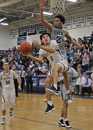 Westerly's Byron Dunn puts up a shot against Shea's Erickson Bans during  Tuesday's Division II quarterfinal. | | thewesterlysun.com