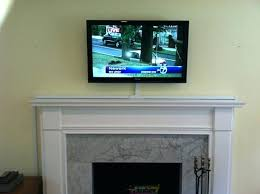 hiding tv wires over fireplace enter image description here hide flat screen tv wires over fireplace