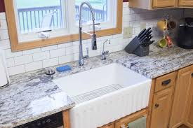 so they decided to go ahead and replace their existing laminate countertops with a granite upgrade the lighter colored granite helped brighten the area