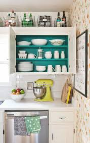 pop of color inside cabinets, wall of paper, wire basket storage. I love  this color, wouldn't want it throughout the kitchen, but a wonderful  surprise when ...