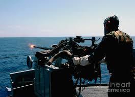 U S Navy Gunners Mate Fires A Mark 38 Photograph By Stocktrek Images