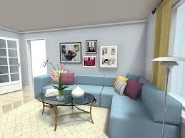 living room ideas art wall above blue sofa