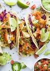 baja fish tacos with fresh avocado cream and cilantro salsa