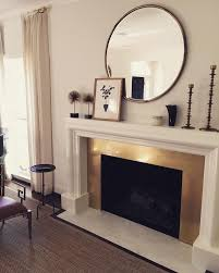 mirror over fireplace. brass fireplace surround via @ladolcevitablog instagram · mirror above over a
