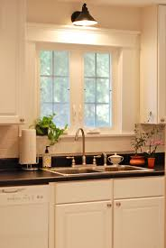 Sconces In The Kitchen Dream Home Kitchen Sink Lighting Kitchen