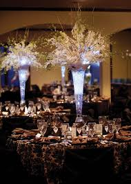 tall wedding centerpieces but with a deep purple light in centerpieces i even like