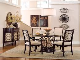 round black glass dining table top with brown iron pedestal base furniture plus wooden chairs white