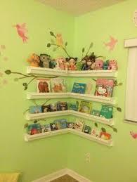 Rain gutter shelves for books and stuffed animals