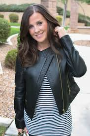 tan black leather jacket black and white striped tunic dark rinse skinny jeans
