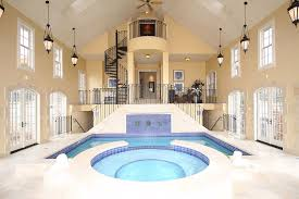 indoor pool house. Gorgeous Residential Indoor Pool Interior Design With Round And Rectangular Shaped Pools White Ceramic Floor Tile Brown Wall Paint Color Also House T