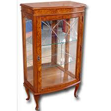 this inlaid mahogany corner display dates from circa 1900 and is in very nice and tidy original condition but with the interior relined so that is in