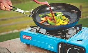 Cooking on camp stove 10 Best Camping Stoves for Car in 2019 - Cool of the Wild