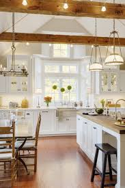 exposed beams with accent lighting are one of the features in this sudbury ma kitchen accent lighting family room