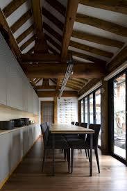 image source Traditional Korean Hanoks: Interior of a modernized hanok with  a dining area, dark chairs