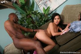 An Asian girl doing a hung black man from Axel