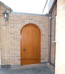 idigbo arched gate fitted within archway