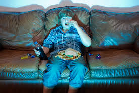 kids watching tv and eating. tight family budget may lessen impact of food commercials on children kids watching tv and eating