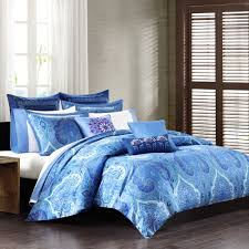 luxurious oversized duvet cover in blue with beautiful patterns white bedding a lot of pillows with