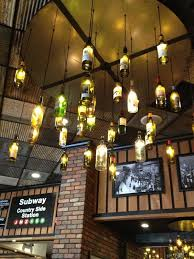 cool wine bottle pendant lights see all our here httpwwwlightsforalloccasionscomc389winebottlelightsaspx cool bar lighting c51 lighting
