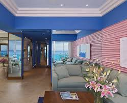 Ocean Living Room Pink Sectional Sofa Living Room Tropical With Mirror Mirrored Wall