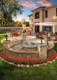 enjoy this outdoor living space in your backyard. Pergolas and fire pits  from Cambridge pavers provide the best designs for relaxation.