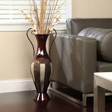 Metal Floor Vase With Sofa And Flowers And Living Room Area