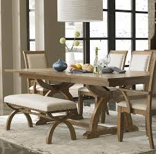 rustic modern dining room design with solid wood trestle dining table with white leather benches with wooden base and chairs with arms and high back ideas