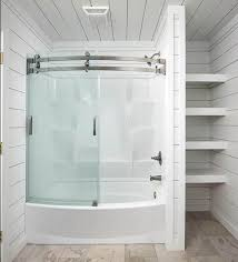 bathroom with white shiplap walls and ceiling and laminate floors