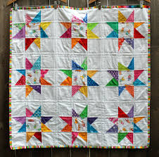 wonky star quilt | WOMBAT QUILTS & For this quilt I used a darling fussy cut novelty fabric for the center  piece and then bright scraps for the star points. Most of these scrap  triangles were ... Adamdwight.com