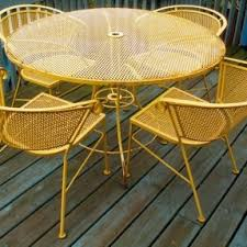 vintage wrought iron garden furniture. Patio Furniture Set Consisting Of A Round Table With Hole For An Umbrella And 4 Vintage Wrought Iron Garden F