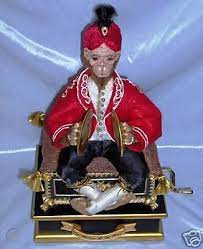 One of the items is a stuffed monkey dressed in persian robes and playing the cymbals sitting on top of a music box. Phantom Of The Opera Movie Replica Monkey Music Box 46606676
