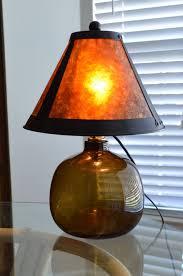 tortoise lighting. Brown Glass Fillable Bottle Table Lamp With Tortoise Shell Shade Lighting