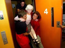 people stuck in elevator. do not leave a stalled elevator until you are being assisted by emergency responders, like people stuck in o